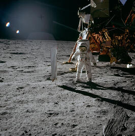 Buzz Aldrin looking at the Solar Wind Experiment, with Apollo 11 in the background